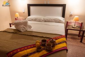Una cama o camas en una habitación de Mini Hostería Termas de Fiambala
