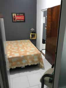 A bed or beds in a room at Residencial San Francisco