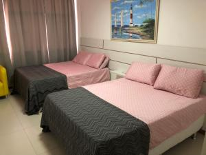 A bed or beds in a room at Luxury 3 Bedroom Apartment - Barra