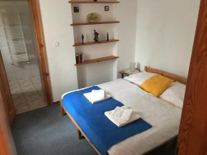 A bed or beds in a room at Pension Abbazia