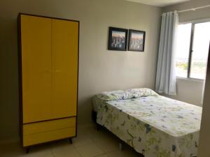 A bed or beds in a room at Residencial Parque Maceió