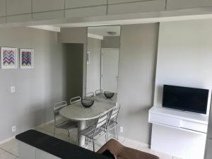 A television and/or entertainment centre at Residencial Parque Maceió