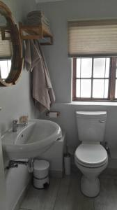 A bathroom at 24 ON HIGH - Guest Cottage