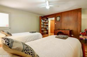 A bed or beds in a room at Serenity@Montville