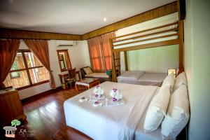 A bed or beds in a room at K.B. Resort