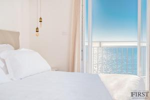 A bed or beds in a room at Il Sogno di Manarola by The First