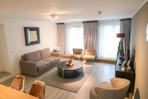 A seating area at Hotel-Restaurant Gulpenerland