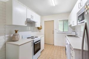 A kitchen or kitchenette at Relaxation on Rigney Street