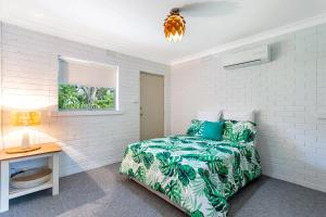 A bed or beds in a room at Relaxation on Rigney Street