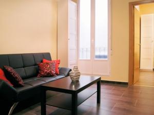 Zona de estar de Apartamentos Champs-Élysées
