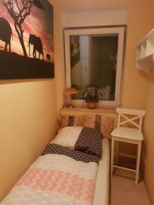 Ein Bett oder Betten in einem Zimmer der Unterkunft Haus am See