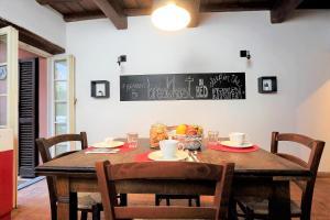 Ein Restaurant oder anderes Speiselokal in der Unterkunft San Callisto