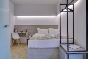 Ein Bett oder Betten in einem Zimmer der Unterkunft athensotel.com