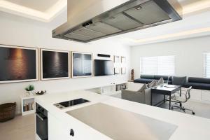 A kitchen or kitchenette at Executive Beachside Loft - A Bondi Beach Holiday Home