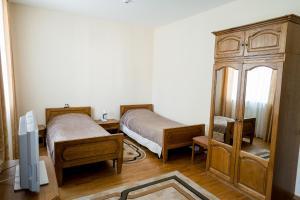 Кровать или кровати в номере Гостиничный Комплекс Каменюки
