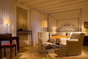 Area soggiorno di Relais & Chateaux Palazzo Seneca