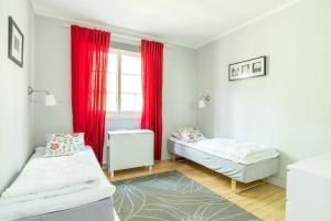 Säng eller sängar i ett rum på First Camp Bredsand-Enköping