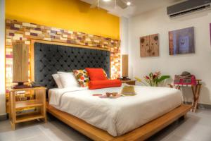 Casa de Leda, a Kali Hotelにあるベッド