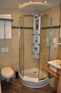 Ein Badezimmer in der Unterkunft Hotel de Savoie