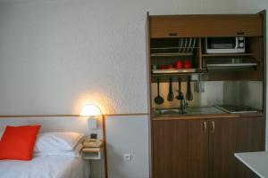 Un ou plusieurs lits dans un hébergement de l'établissement Hôtel des Thermes Les Dômes
