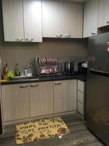 A kitchen or kitchenette at Jazz Suite Vivacity Megamall Kuching