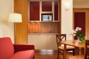 A kitchen or kitchenette at UNAWAY Hotel & Residence Quark Due Milano