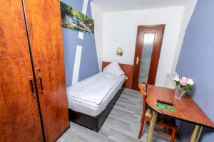 Ein Bett oder Betten in einem Zimmer der Unterkunft Hotel Stern