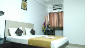 Кровать или кровати в номере Hotel Legend Inn