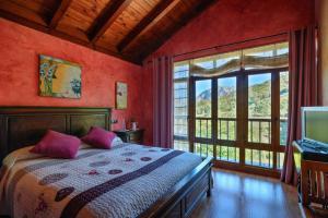 Cama o camas de una habitación en Apartamentos Rurales Balcón Real Senda del Oso