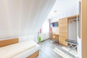 Ein Sitzbereich in der Unterkunft Hotel Reinhardtshof Garni