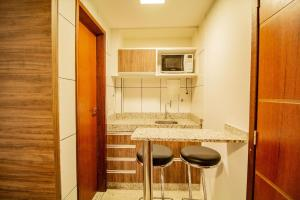 A kitchen or kitchenette at TaguaPark Hotel