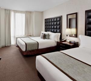 A bed or beds in a room at Distrikt Hotel New York City, Tapestry Collection by Hilton