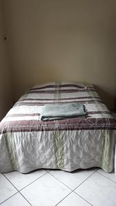 A bed or beds in a room at Bem Estar Família Olegini