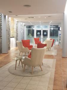 The lobby or reception area at Hotel Balneario De Alceda