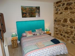 Cama o camas de una habitación en El Muro de Piedra