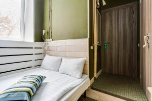 A bed or beds in a room at Loft Hotel P12