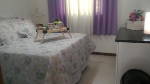 A bed or beds in a room at Stúdio Petrópolis, Alameda das Pedras