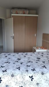 Cama o camas de una habitación en Condominio Estrela do mar