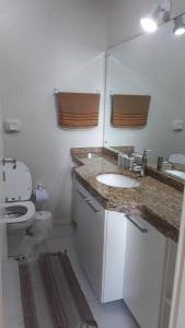 Un baño de Condominio Estrela do mar