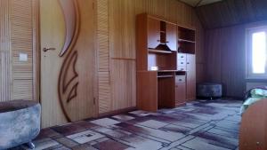Телевизор и/или развлекательный центр в Домик Рыбака