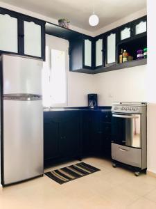 A kitchen or kitchenette at FILRentas TULUM