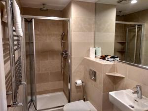 A bathroom at NOX HOTELS - Olympia