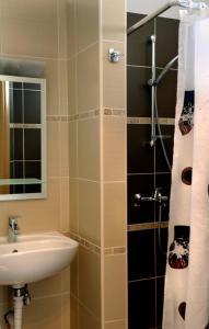 Ένα μπάνιο στο Ενοικιαζόμενα Δωμάτια Νηρηίδες