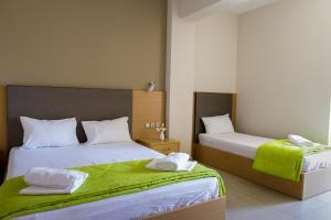 Ένα ή περισσότερα κρεβάτια σε δωμάτιο στο Ενοικιαζόμενα Δωμάτια Νηρηίδες
