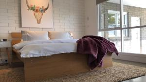 A bed or beds in a room at Casa Dromana
