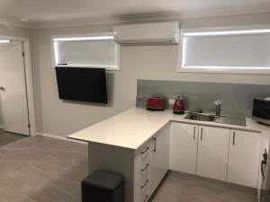A kitchen or kitchenette at The William Apartments Jesmond