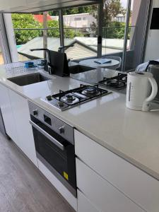 A kitchen or kitchenette at Bondi Beach Studio King Suite + Balcony