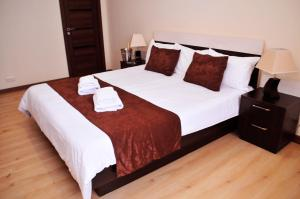A bed or beds in a room at Panorama Resort&Suites