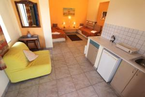 A kitchen or kitchenette at Katerina's Bungalows