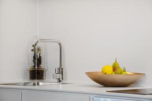 A kitchen or kitchenette at A Luxury home hidden in the Urban oasis